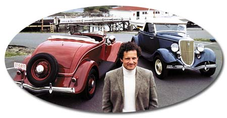 Andrew Timmis between two of his Timmis V-8 Roadsters.
